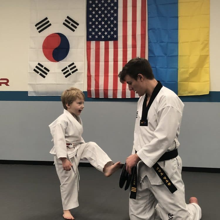 Instructor working with young Taekwondo Student