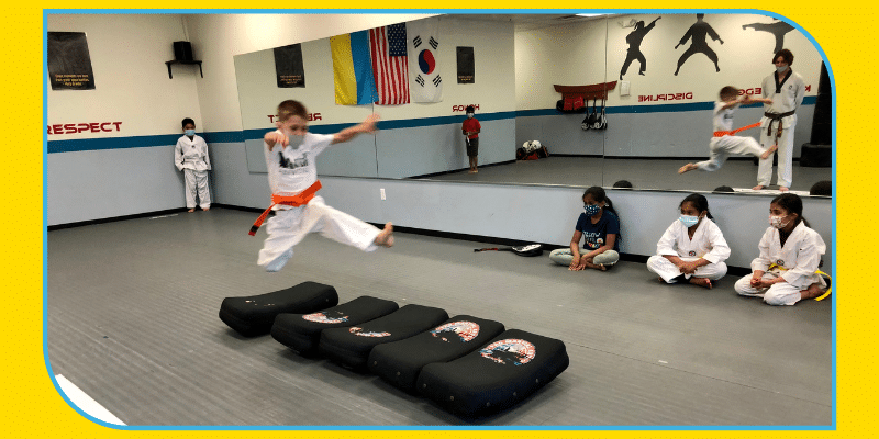 Boy jumps a length greater than his height in martial arts class in Novi Michigan great school