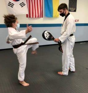 karate kid from South Lyon Michigan learns Taekwondo at his martial arts school in Novi MI Cobra Kai