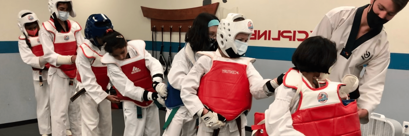 shows Taekwondo class getting ready for sparring in Novi MI