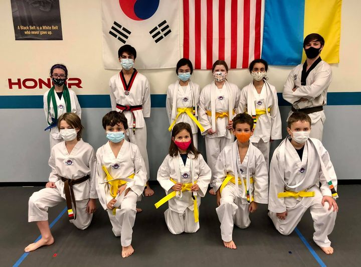 Group Photo of nine Akula Taekwondo students after belt testing with their instructor, Joseph Tegler, and an assistant instructor