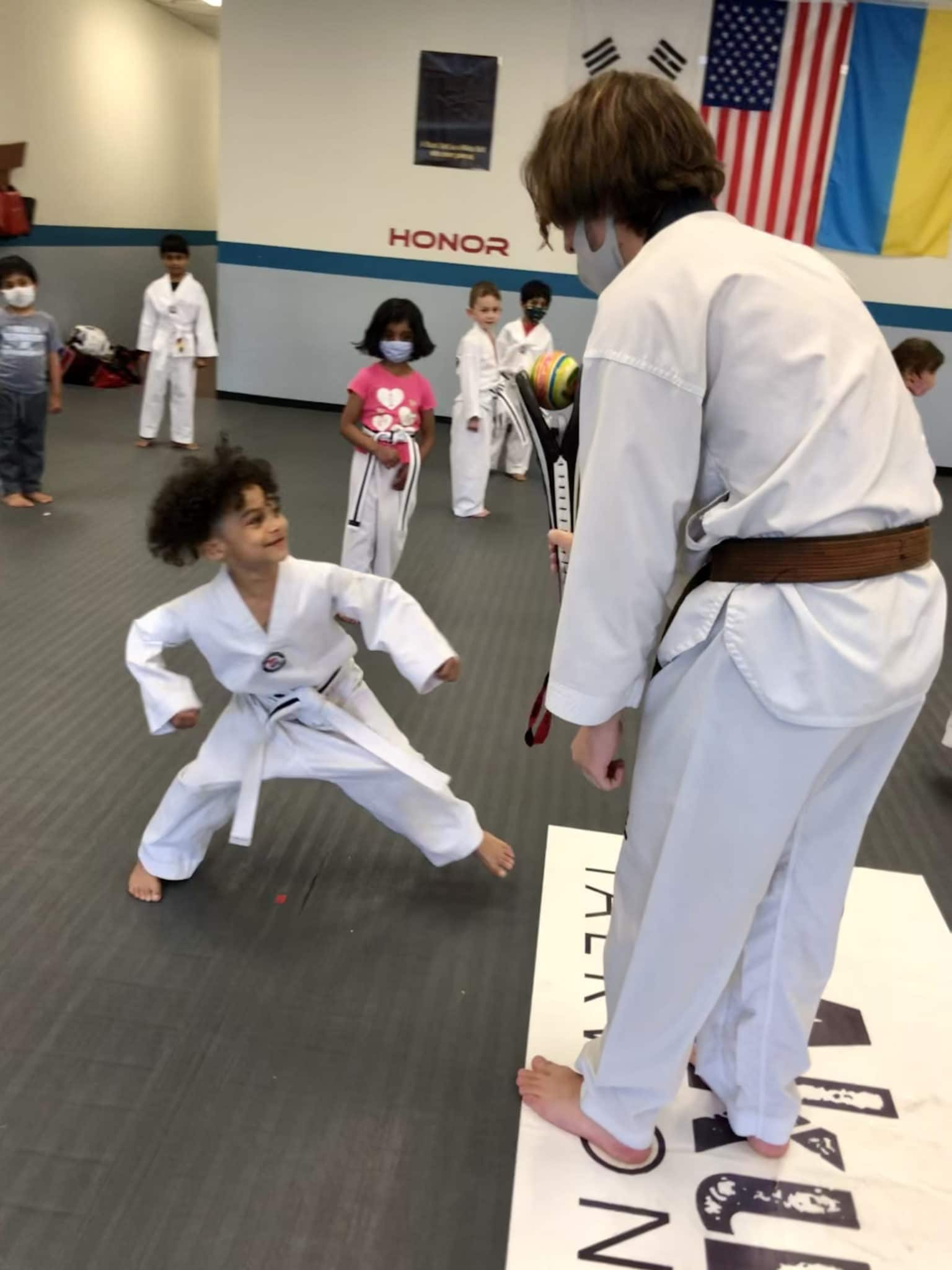 Child smiling and having fun in Karate Kids Class in Novi Michigan